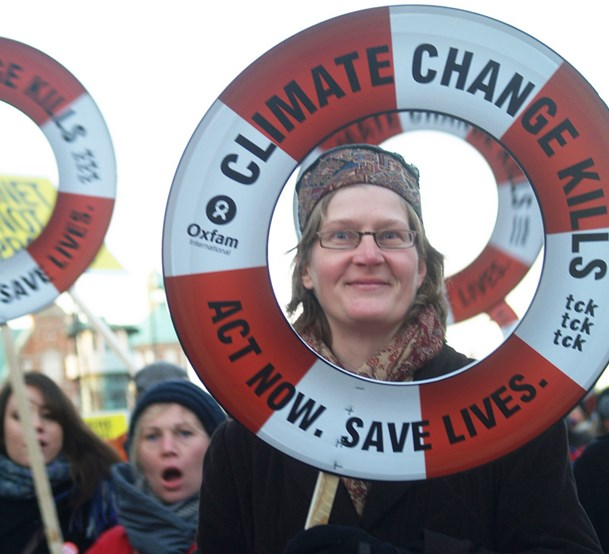 General Motors isn't exactly on the barricades with Oxfam, but it's no longer denying that climate change is real. (Oxfam photo)
