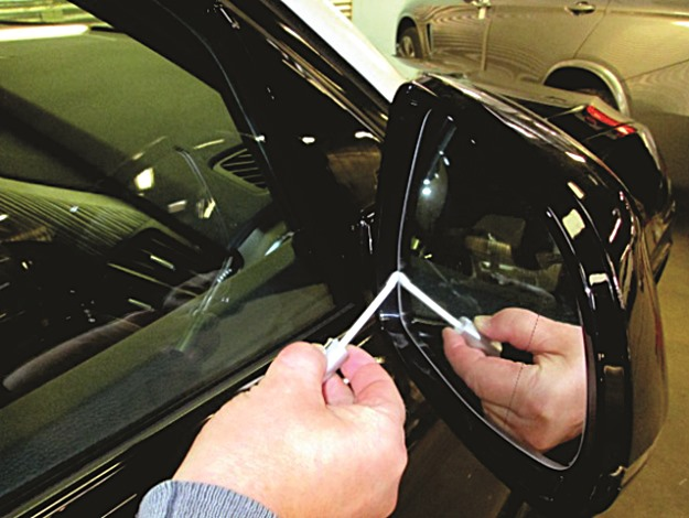 Paging CSI! Using a swab to apply DNA coding to a rear view mirror. (DNA Applied Sciences photo)