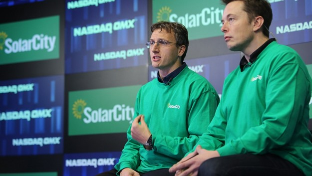 Elon Musk (right) with his cousin Lyndon Rive at a SolarCity event. Musk had the idea for SolarCity, and is both its chairman and its biggest investor. (The NASDAQ OMX Group, Inc.)