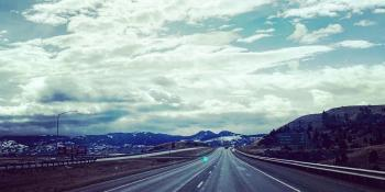 Cloudy sky and open highway