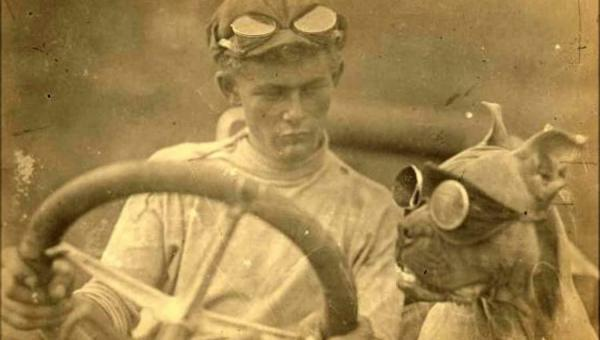 Clive Birtles and dog, Wowser, in Flanders Touring Car, 1912