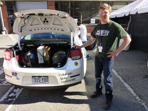 Colorado State faculty advisor Tom Bradley shows off the three carbon-fiber hydrogen tanks in the trunk of his fuel-cell car. (Jim Motavalli photo)
