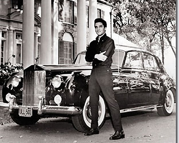 Elvis with his Phantom V Rolls. He did occasionally depart from his beloved Cadillacs.