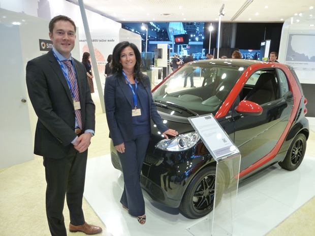 Heiko Schmidt and Tracey Matura with the new and improved Smart car. Electrics are getting renewed focus. (Jim Motavalli photo)