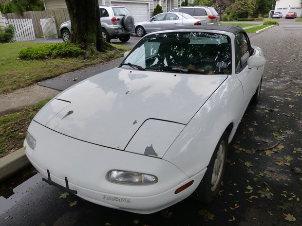 I looked at this Miata around the time of Hurricane Sandy--see the fallen leaves? (Jim Motavalli photo)