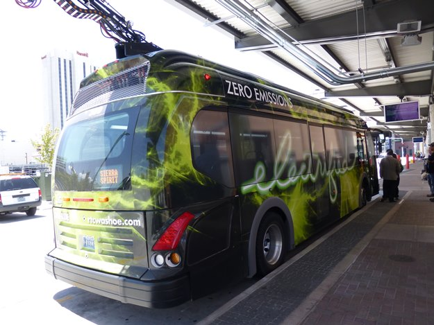 Proterra's electric bus docks for a charge at the LEED-certified Fourth Street Station in Reno. (Jim Motavalli photo)