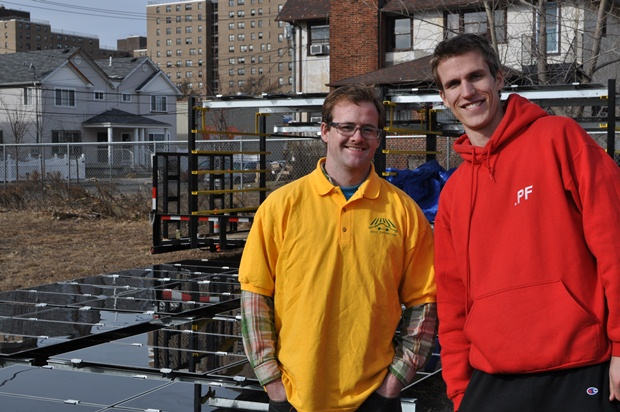 Rob van Haaren (in red) and Garrett Fitzgerald with their portable solar in Queens. (Solar Journey USA photo)