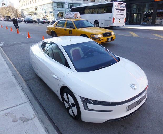 The VW XL1 in Manhattan. Can you believe how tiny it is? But it seats two. (Jim Motavalli photo)